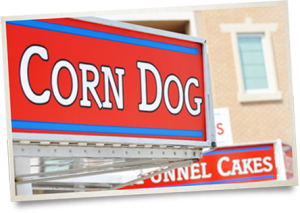 Corn Dog Vendor Sign with Funnel Cakes Sign in Background