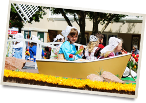 Girl riding a dutch themed parade float.
